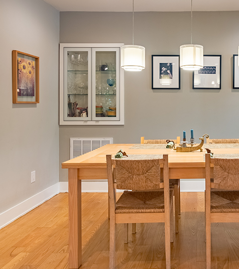 Photo of dining table with pendant lights