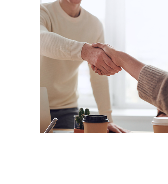 Designer and client shaking hands